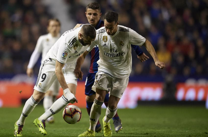 Karim Benzema and Lucas Vazquez of Real Madrid during the week 25 of La Liga match between Levante UD and Real Madrid at Ciutat de Velencia Stadium in Valencia, Spain on February 24, 2019. (Photo by Jose Breton/NurPhoto via Getty Images)