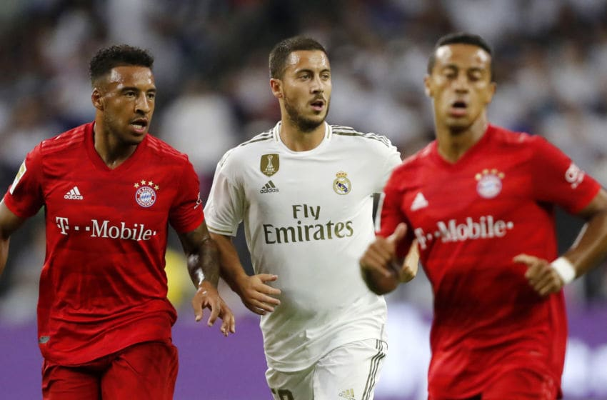 HOUSTON, TX - JULY 20: Jerome Boaten of FC Bayern Muenchen and Eden Hazard of Real Madrid look on during the 2019 International Champions Cup match between FC Bayern Muenchen and Real Madrid at NRG Stadium on July 20, 2019 in Houston, Texas. (Photo by TF-Images/Getty Images)