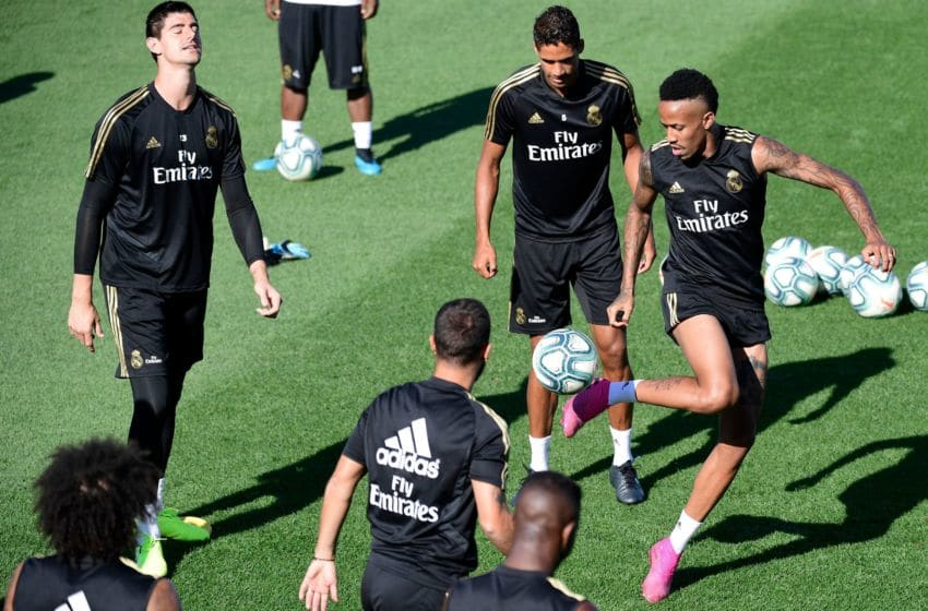 Real Madrid's Brazilian defender Eder Militao (R), Real Madrid's French defender Raphael Varane (C) and Real Madrid's Belgian goalkeeper Thibaut Courtois take part in a training session at Real Madrid's sport city in Madrid on August 16, 2019. (Photo by JAVIER SORIANO / AFP) (Photo credit should read JAVIER SORIANO/AFP/Getty Images)