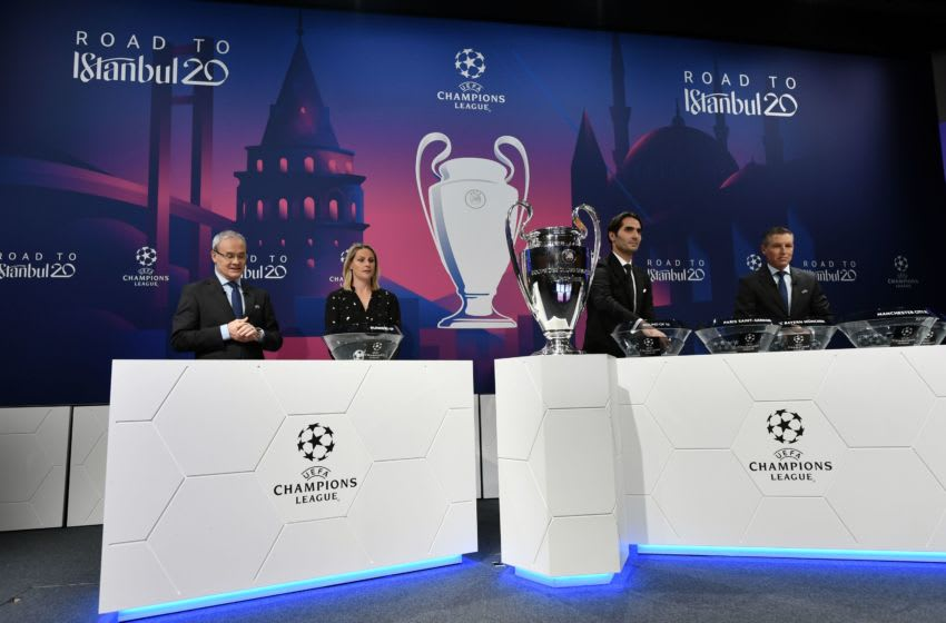 (From L) UEFA deputy general secretary Giorgio Marchetti, UEFA Champions League ambassador Kelly Smith, UEFA Champions League's ambassador Hamit Altintop and UEFA head of club competitions Michael Heselschwerdt attend the UEFA Champions League football cup round of 16 draw ceremony on December 16, 2019 in Nyon. (Photo by Fabrice COFFRINI / AFP) (Photo by FABRICE COFFRINI/AFP via Getty Images)
