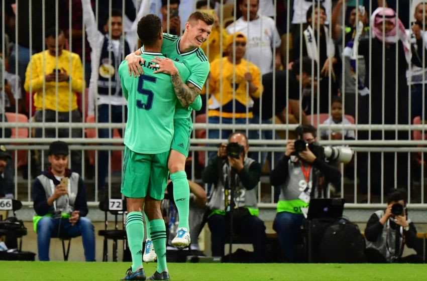 Real Madrid's German midfielder Toni Kroos (R) celebrates his goal with Real Madrid's French defender Raphael Varane during the Spanish Super Cup semi final between Valencia and Real Madrid on January 8, 2020, at the King Abdullah Sport City in the Saudi Arabian port city of Jeddah. (Photo by GIUSEPPE CACACE / AFP) (Photo by GIUSEPPE CACACE/AFP via Getty Images)