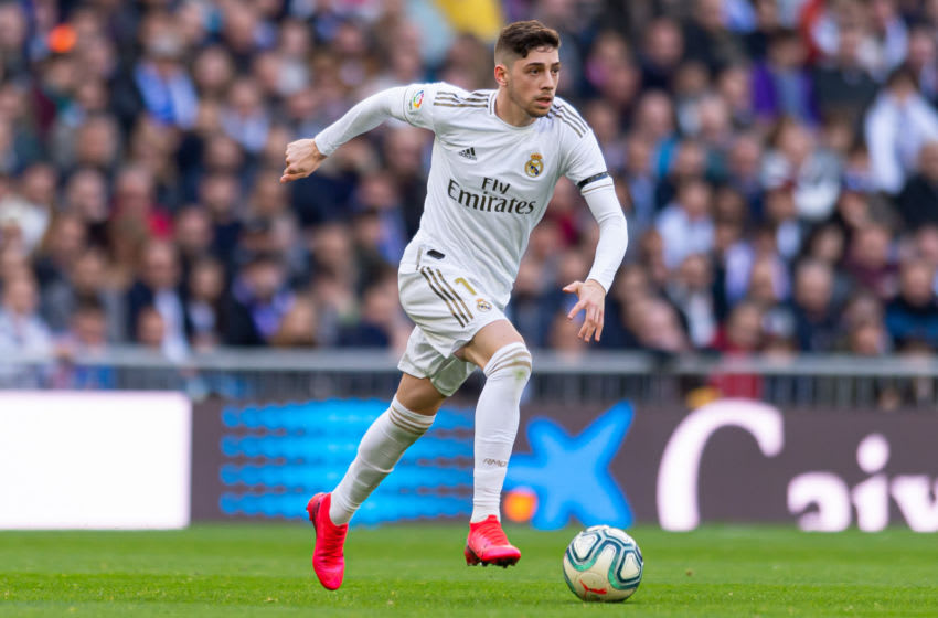 MADRID, SPAIN - FEBRUARY 01: (BILD ZEITUNG OUT) Federico Valverde of Real Madrid controls the ball during the Liga match between Real Madrid CF and Club Atletico de Madrid at Estadio Santiago Bernabeu on February 01, 2020 in Madrid, Spain. (Photo by TF-Images/Getty Images)