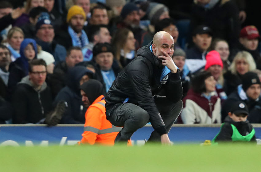 MANCHESTER, ENGLAND - JANUARY 29: Pep Guardiola the manager of Manchester City looks on during the Carabao Cup Semi Final match between Manchester City and Manchester United at Etihad Stadium on January 29, 2020 in Manchester, England. (Photo by Alex Livesey - Danehouse/Getty Images)
