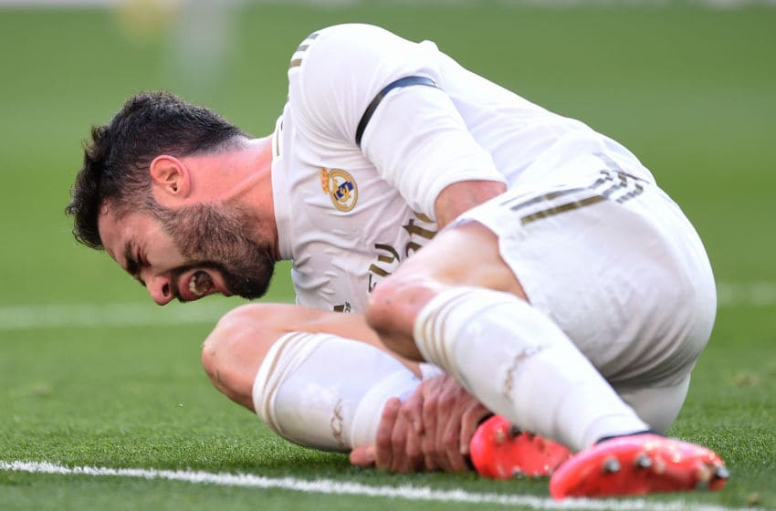 MADRID, SPAIN - FEBRUARY 01: Dani Carvajal of Real Madrid reacts after taking a knock during the Liga match between Real Madrid CF and Club Atletico de Madrid at Estadio Santiago Bernabeu on February 01, 2020 in Madrid, Spain. (Photo by Denis Doyle/Getty Images)