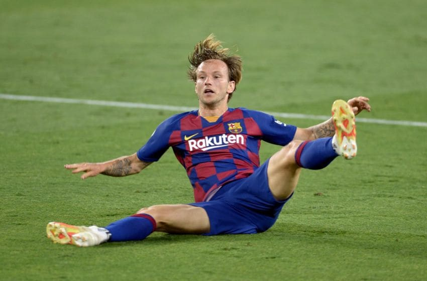 Barcelona's Croatian midfielder Ivan Rakitic falls during the Spanish league football match between Sevilla FC and FC Barcelona at the Ramon Sanchez Pizjuan stadium in Seville on June 19, 2020. (Photo by CRISTINA QUICLER / AFP) (Photo by CRISTINA QUICLER/AFP via Getty Images)