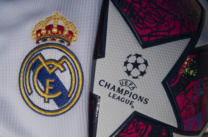 WHICHFORD, ENGLAND - MAY 06: Real Madrid club crest on the home shirt for the 2019-20 season next to UEFA Champions League logo and branding on the adidas