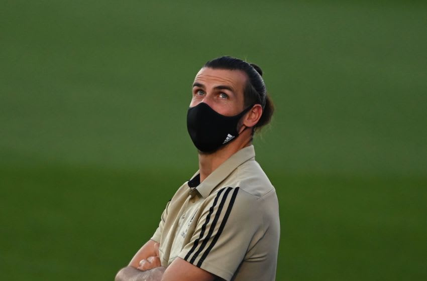 Real Madrid's Welsh forward Gareth Bale wears a face mask before the Spanish league football match Real Madrid CF against Getafe CF at the Alfredo di Stefano stadium in Valdebebas, on the outskirts of Madrid, on July 2, 2020. (Photo by GABRIEL BOUYS / AFP) (Photo by GABRIEL BOUYS/AFP via Getty Images)