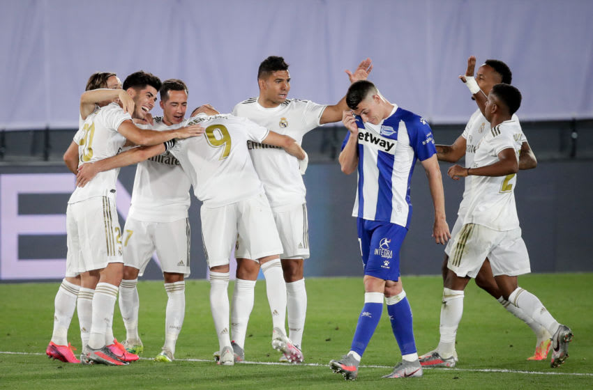 VALDEBEBAS, SPAIN - JULY 10: Marco Asensio of Real Madrid, Lucas Vazquez of Real Madrid, Karim Benzema of Real Madrid, Raphael Varane of Real Madrid, Rodrygo of Real Madrid, Eder Militao of Real Madrid, celebrates the 2-0 during the La Liga Santander match between Real Madrid v Deportivo Alaves at the Stadium Ciudad Deportiva Real Madrid on July 10, 2020 in Valdebebas Spain (Photo by David S. Bustamante/Soccrates/Getty Images)