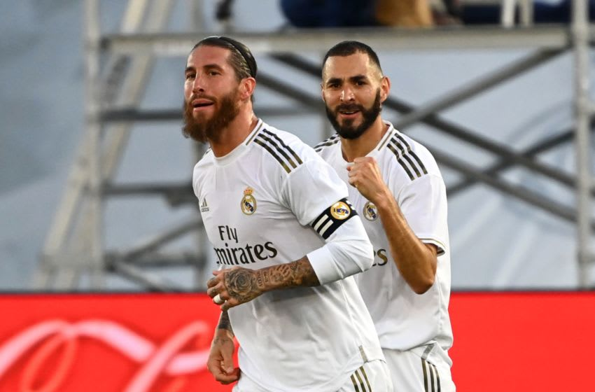 Real Madrid's French forward Karim Benzema (R) celebrates with Real Madrid's Spanish defender Sergio Ramos after scoring during the Spanish League football match between Real Madrid CF and Villarreal CF at the Alfredo di Stefano stadium in Valdebebas, on the outskirts of Madrid, on July 16, 2020. (Photo by GABRIEL BOUYS / AFP) (Photo by GABRIEL BOUYS/AFP via Getty Images)