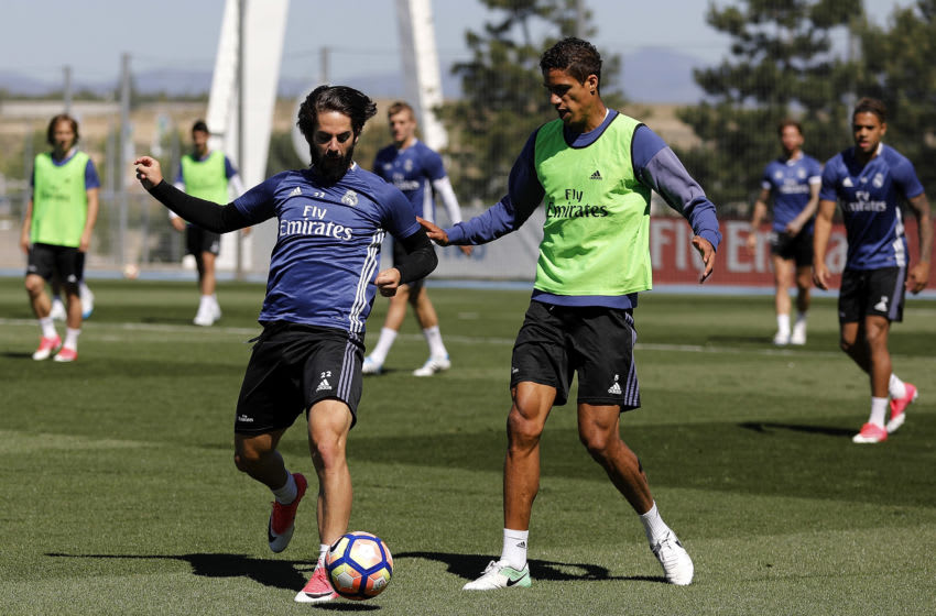 MADRID, SPAIN - MAY 20: Isco (L) and Raphael Varane of Real Madrid in action during a training session at Valdebebas training ground on May 20, 2017 in Madrid, Spain. (Photo by Angel Martinez/Real Madrid via Getty Images)