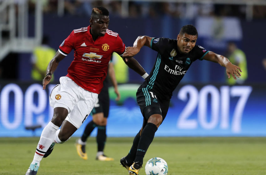 SKOPJE, MACEDONIA - AUGUST 08: Casemiro of Real Madrid is chased by Paul Pogba of Manchester United during the UEFA Super Cup match between Real Madrid and Manchester United at Philip II Arena on August 8, 2017 in Skopje, Macedonia. (Photo by Angel Martinez/Real Madrid via Getty Images)