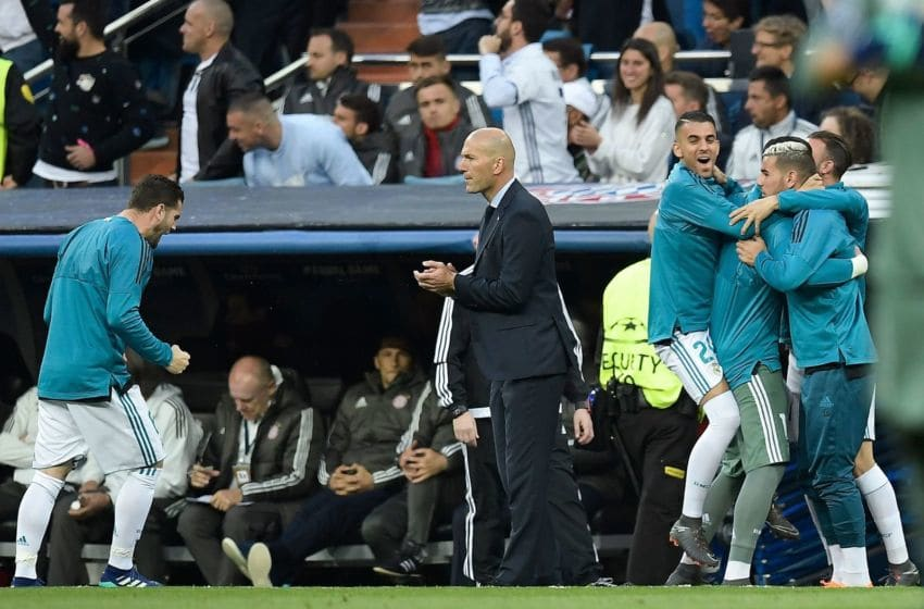 Real Madrid's French coach Zinedine Zidane (C) celebrates next to players on the bench after their team scored a goal during the UEFA Champions League semi-final second leg football match between Real Madrid and Bayern Munich at the Santiago Bernabeu Stadium in Madrid on May 1, 2018. (Photo by OSCAR DEL POZO / AFP) (Photo credit should read OSCAR DEL POZO/AFP/Getty Images)