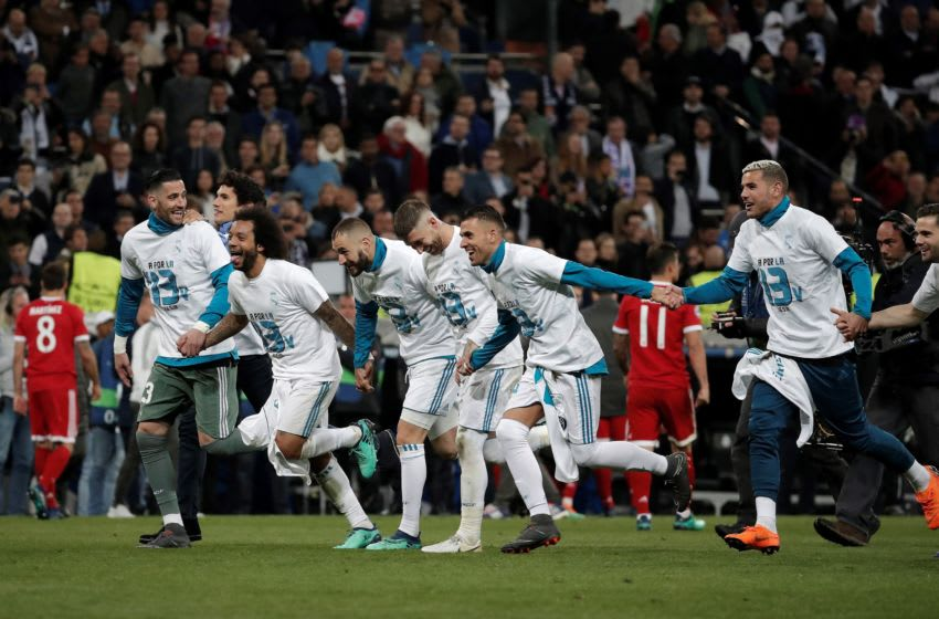 MADRID, SPAIN - MAY 1: Footballers of Real Madrid celebrate their victory at the end of the UEFA Champions League semi final second leg match between Real Madrid and FC Bayern Munich at the Santiago Bernabeu Stadium in Madrid, Spain on May 1, 2018. (Photo by Burak Akbulut/Anadolu Agency/Getty Images)