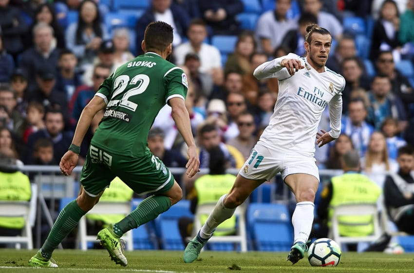 MADRID, SPAIN - APRIL 28: Gareth Bale of Real Madrid (R) competes for the ball with Dimitrios Siovas of Leganes during the La Liga match between Real Madrid and Leganes at Estadio Santiago Bernabeu on April 28, 2018 in Madrid, Spain. (Photo by Quality Sport Images/Getty Images)
