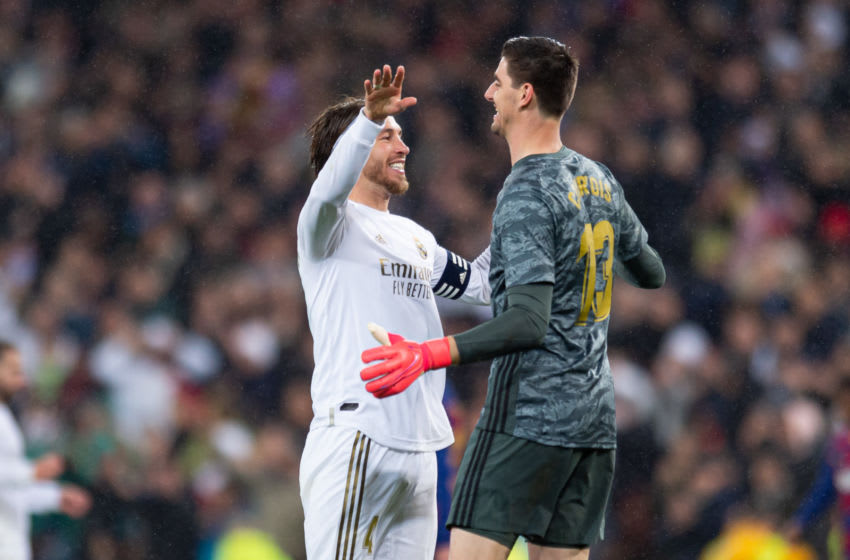 MADRID, SPAIN - MARCH 01: (BILD ZEITUNG OUT) Sergio Ramos of Real Madrid and goalkeeper Thibaut Courtois of Real Madrid celebrate after winning during the Liga match between Real Madrid CF and FC Barcelona at Estadio Santiago Bernabeu on March 1, 2020 in Madrid, Spain. (Photo by Alejandro Rios/DeFodi Images via Getty Images)