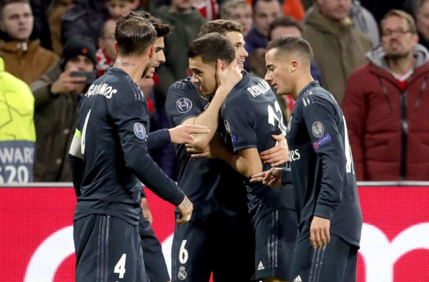 AMSTERDAM, NETHERLANDS - FEBRUARY 13: Sergio Ramos of Real Madrid, Marco Asensio of Real Madrid, Lucas Vazquez of Real Madrid, Sergio Reguilon of Real Madrid celebrate 1-2 during the UEFA Champions League match between Ajax v Real Madrid at the Johan Cruijff Arena on February 13, 2019 in Amsterdam Netherlands (Photo by Geert van Erven/Soccrates/Getty Images)