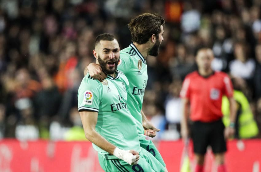 VALENCIA, SPAIN - DECEMBER 15: (L-R) Karim Benzema of Real Madrid, Nacho of Real Madrid celebrates goal 1-1 during the La Liga Santander match between Valencia v Real Madrid at the Estadio de Mestalla on December 15, 2019 in Valencia Spain (Photo by David S. Bustamante/Soccrates/Getty Images)
