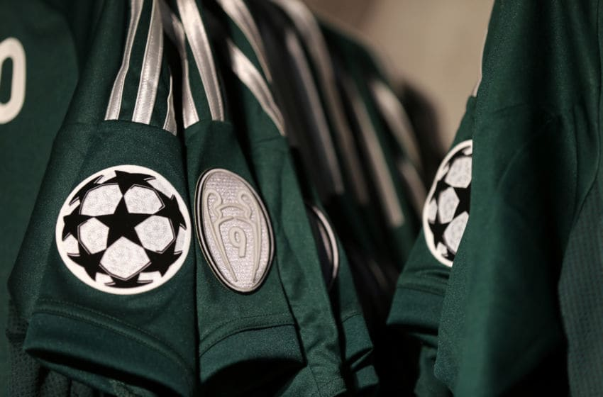 UEFA Champions League logo and a badge commemorating the nine trophies won on an away shirt on sale in the club shop at the Santiago Bernabeu the home stadium of Real Madrid (Photo by AMA/Corbis via Getty Images)