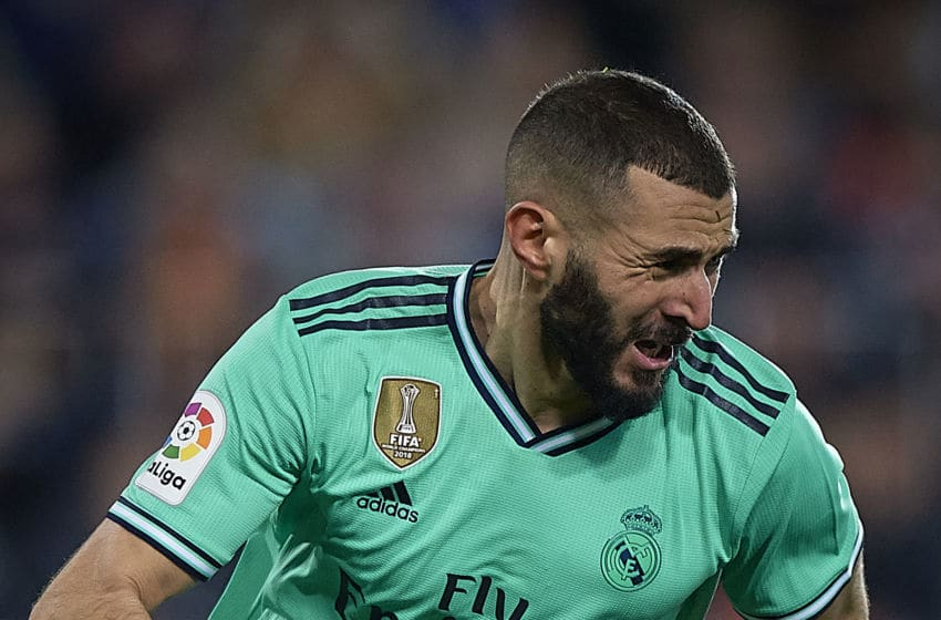 VALENCIA, SPAIN - DECEMBER 15: Karim Benzema of Real Madrid celebrates a after scoring a goal during the Liga match between Valencia CF and Real Madrid CF at Estadio Mestalla on December 15, 2019 in Valencia, Spain. (Photo by Pablo Morano/MB Media/Getty Images)