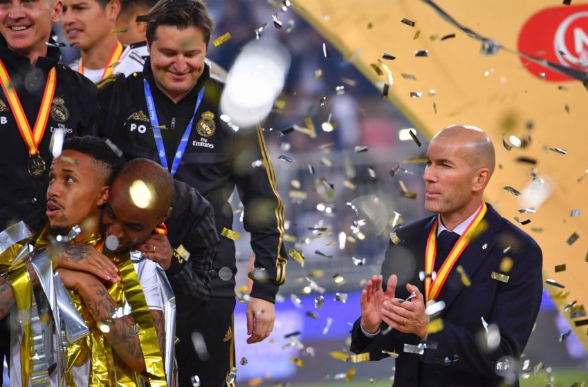 Real Madrid's French coach Zinedine Zidane (R) claps for his players after winning the Spanish Super Cup final between Real Madrid and Atletico Madrid on January 12, 2020, at the King Abdullah Sports City in the Saudi Arabian port city of Jeddah. (Photo by Giuseppe CACACE / AFP) (Photo by GIUSEPPE CACACE/AFP via Getty Images)