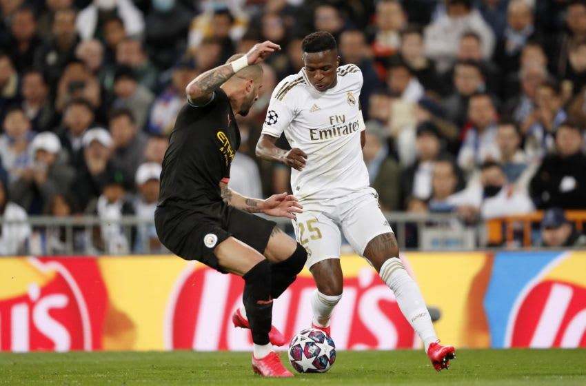 (L-R) Kyle Walker of Manchester City, Vinicius Junior of Real Madrid during the UEFA Champions League round of 16 first leg match between Real Madrid and Manchester City FC at the Santiago Bernabeu stadium on February 26, 2020 in Madrid, Spain(Photo by ANP Sport via Getty Images)