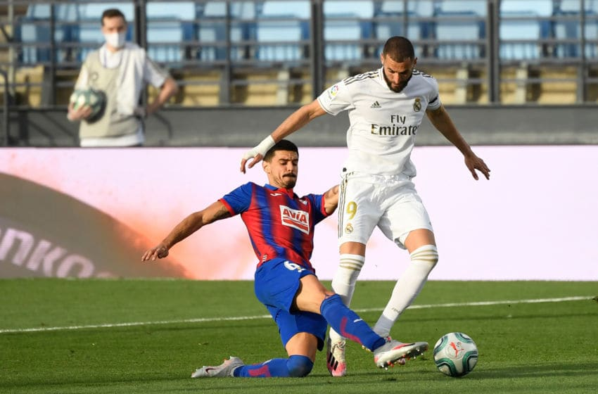 Real Madrid's French forward Karim Benzema (R) vies with Eibar's Spanish midfielder Sergio Alvarez during the Spanish League football match between Real Madrid CF and SD Eibar at the Alfredo di Stefano stadium in Valdebebas, on the outskirts of Madrid, on June 14, 2020. (Photo by PIERRE-PHILIPPE MARCOU / AFP) (Photo by PIERRE-PHILIPPE MARCOU/AFP via Getty Images)