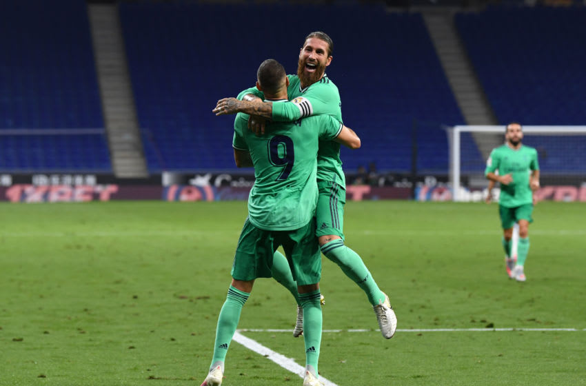 BARCELONA, SPAIN - JUNE 28: Sergio Ramos celebrates with teammate Karim Benzema of Real Madrid after their side's first goal during the Liga match between RCD Espanyol and Real Madrid CF at RCDE Stadium on June 28, 2020 in Barcelona, Spain. (Photo by David Ramos/Getty Images)