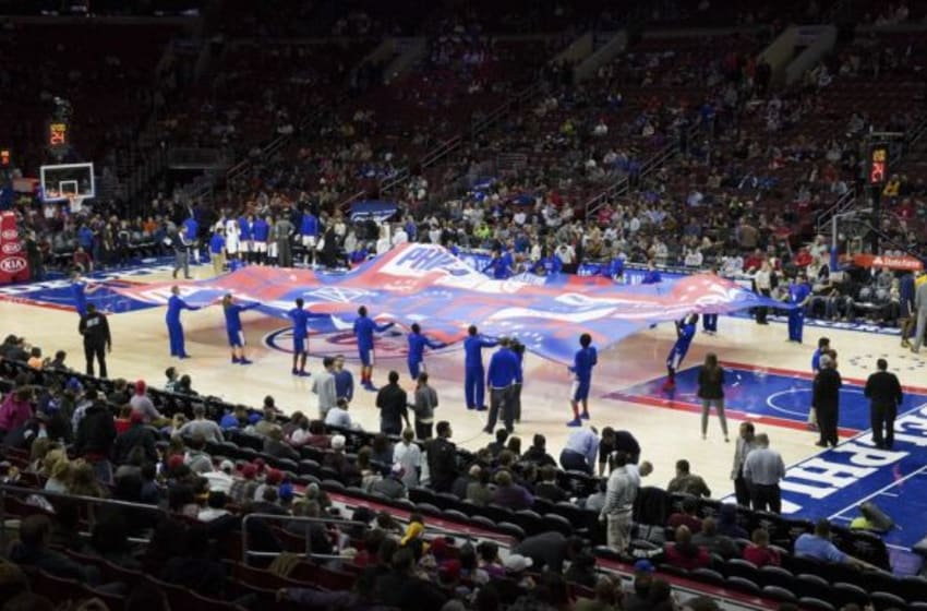 Nov 18, 2015; Philadelphia, PA, USA; The Sixers flight squad holds a giant Philadelphia 76ers flag on the court to start the second half against the Indiana Pacers at Wells Fargo Center. The Pacers won 112-85. Mandatory Credit: Bill Streicher-USA TODAY Sports