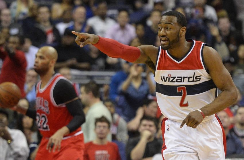 Mar 16, 2016; Washington, DC, USA; Washington Wizards guard John Wall (2) signals to a teammate as he runs down the court during the first half against the Chicago Bulls at Verizon Center. Mandatory Credit: Tommy Gilligan-USA TODAY Sports