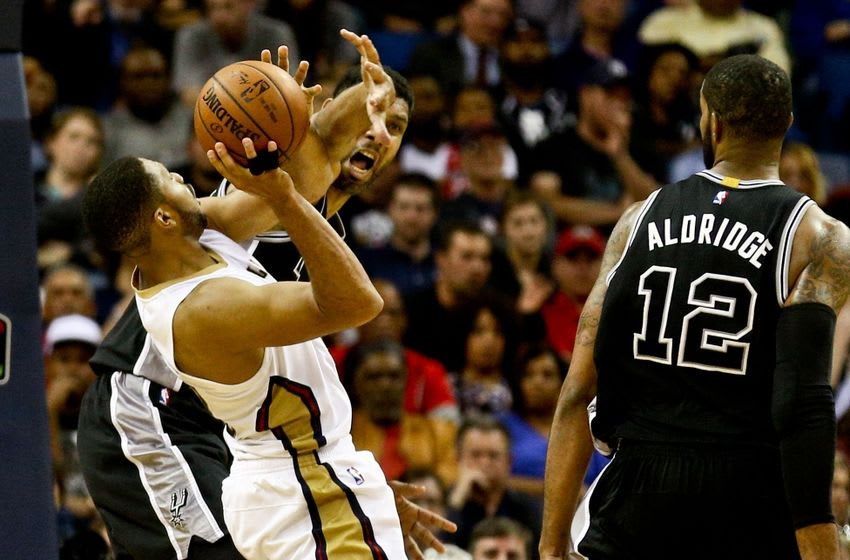 Mar 3, 2016; New Orleans, LA, USA; San Antonio Spurs center Tim Duncan (21) defends against New Orleans Pelicans guard Eric Gordon (10) during the fourth quarter of a game at the Smoothie King Center. The Spurs defeated the Pelicans 94-86. Mandatory Credit: Derick E. Hingle-USA TODAY Sports