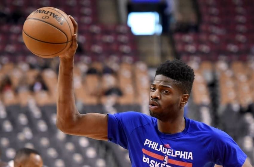 Apr 12, 2016; Toronto, Ontario, CAN; Philadelphia 76ers forward Nerlens Noel (4) takes a pass during shooting drills prior to playing Toronto Raptors at Air Canada Centre. Mandatory Credit: Dan Hamilton-USA TODAY Sports