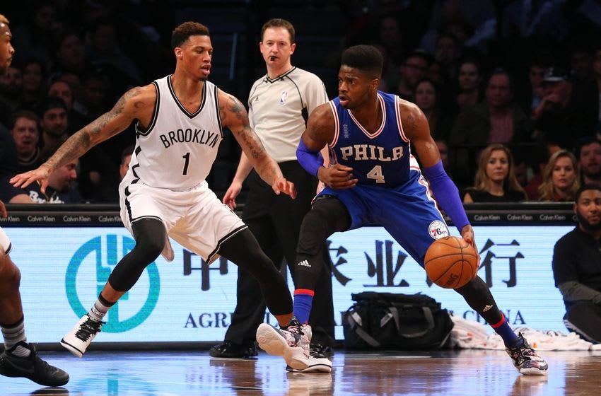 Mar 15, 2016; Brooklyn, NY, USA; Philadelphia 76ers forward Nerlens Noel (4) looks to drive around Brooklyn Nets forward Chris McCullough (1) during the second quarter at Barclays Center. Mandatory Credit: Anthony Gruppuso-USA TODAY Sports