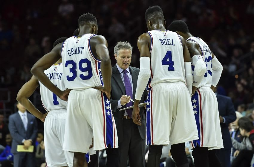 Apr 10, 2016; Philadelphia, PA, USA; Philadelphia 76ers head coach Brett Brown goes over a play with his team during the third quarter of the game against the Milwaukee Bucks at the Wells Fargo Center. The Milwaukee Bucks won 109-108 in OT. Mandatory Credit: John Geliebter-USA TODAY Sports