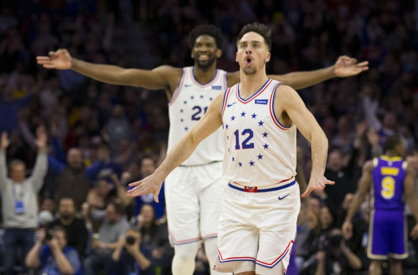 Philadelphia 76ers, T.J. McConnell and Joel Embiid (Photo by Mitchell Leff/Getty Images)