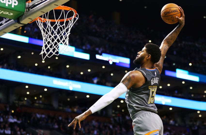 BOSTON, MA - MARCH 20: Paul George #13 of the Oklahoma City Thunder dunks the ball during a game against the Boston Celtics at TD Garden on March 20, 2018 in Boston, Massachusetts. NOTE TO USER: User expressly acknowledges and agrees that, by downloading and or using this photograph, User is consenting to the terms and conditions of the Getty Images License Agreement. (Photo by Adam Glanzman/Getty Images)