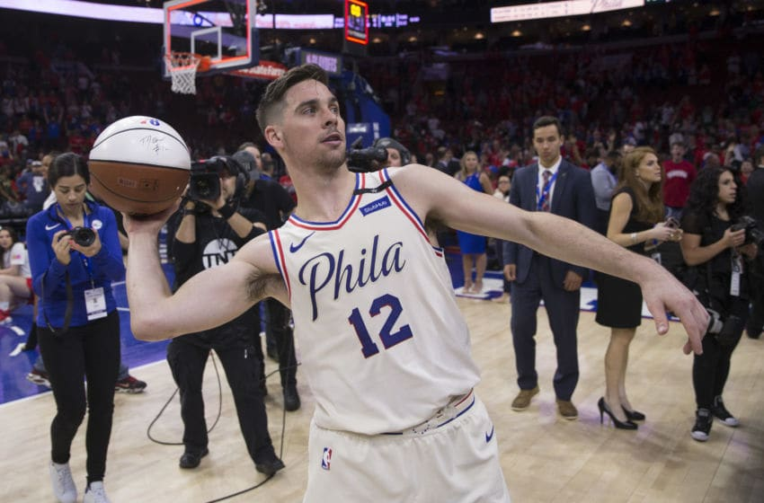 PHILADELPHIA, PA - MAY 7: T.J. McConnell #12 of the Philadelphia 76ers throws an autographed basketball after the game against the Boston Celtics during Game Four of the Eastern Conference Second Round of the 2018 NBA Playoff at Wells Fargo Center on May 7, 2018 in Philadelphia, Pennsylvania. NOTE TO USER: User expressly acknowledges and agrees that, by downloading and or using this photograph, User is consenting to the terms and conditions of the Getty Images License Agreement. (Photo by Mitchell Leff/Getty Images)