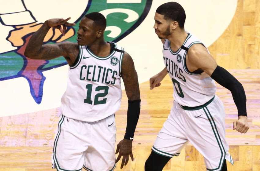 BOSTON, MA - APRIL 15: Terry Rozier #12 of the Boston Celtics celebrates with Jayson Tatum #0 after hitting a three point shot during the fourth quarter of Game One of Round One of the 2018 NBA Playoffs against the Milwaukee Bucks during at TD Garden on April 15, 2018 in Boston, Massachusetts. (Photo by Maddie Meyer/Getty Images)