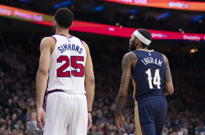 PHILADELPHIA, PA - DECEMBER 13: Ben Simmons #25 of the Philadelphia 76ers and Brandon Ingram #14 of the New Orleans Pelicans in action at the Wells Fargo Center on December 13, 2019 in Philadelphia, Pennsylvania. The 76ers defeated the Pelicans 116-109. NOTE TO USER: User expressly acknowledges and agrees that, by downloading and/or using this photograph, user is consenting to the terms and conditions of the Getty Images License Agreement. (Photo by Mitchell Leff/Getty Images)