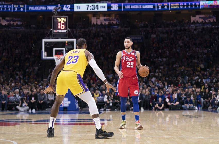 PHILADELPHIA, PA - JANUARY 25: Ben Simmons #25 of the Philadelphia 76ers dribbles the ball against LeBron James #23 of the Los Angeles Lakers at the Wells Fargo Center on January 25, 2020 in Philadelphia, Pennsylvania. NOTE TO USER: User expressly acknowledges and agrees that, by downloading and/or using this photograph, user is consenting to the terms and conditions of the Getty Images License Agreement. (Photo by Mitchell Leff/Getty Images)