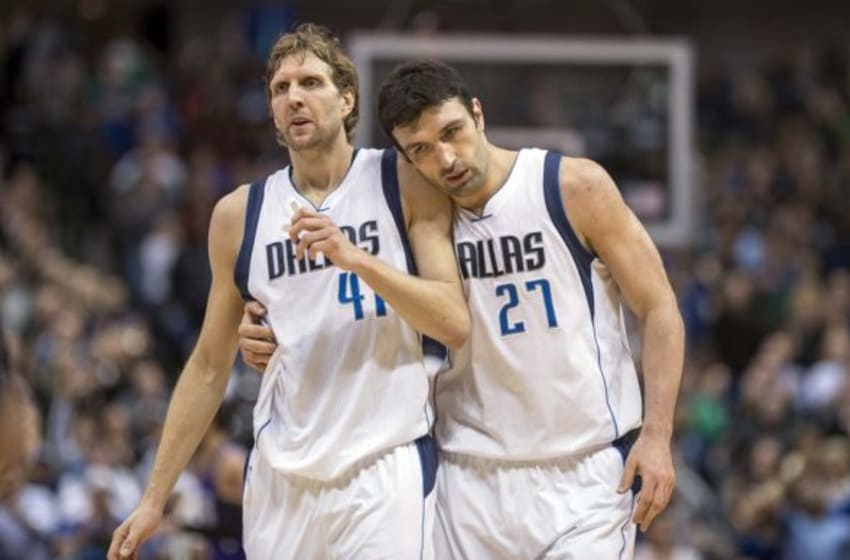 Jan 5, 2016; Dallas, TX, USA; Dallas Mavericks center Zaza Pachulia (27) hugs forward Dirk Nowitzki (41) as they come off the court during the overtime period against the Sacramento Kings at the American Airlines Center. The Mavericks defeat the Kings 117-116 in double overtime. Mandatory Credit: Jerome Miron-USA TODAY Sports