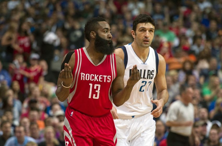 Apr 6, 2016; Dallas, TX, USA; Houston Rockets guard James Harden (13) celebrates making a three point shot as Dallas Mavericks center Zaza Pachulia (27) looks on during the first quarter at the American Airlines Center. Mandatory Credit: Jerome Miron-USA TODAY Sports