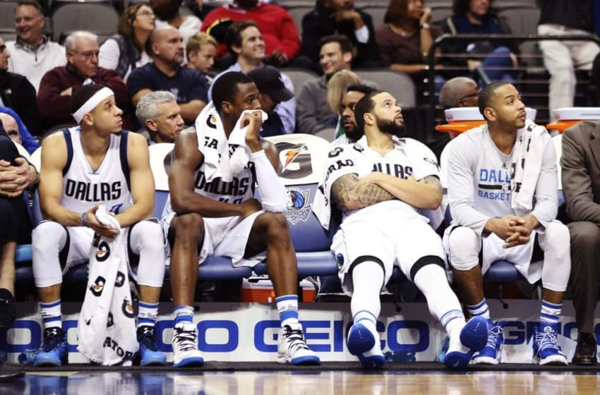 Dec 14, 2016; Dallas, TX, USA; (From left to right) Dallas Mavericks guard Seth Curry (30) and forward Harrison Barnes (40) and guard Deron Williams (8) and guard Devin Harris (34) react on the bench during the second half against the Dallas Mavericks at American Airlines Center. Mandatory Credit: Kevin Jairaj-USA TODAY Sports