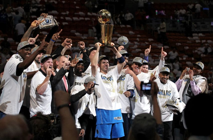 MIAMI, FL - JUNE 12: Jason Kidd #2 of the Dallas Mavericks holds up the Larry O'Brien Championship trophy as he celebrates with his teammates and team owner Mark Cuban after they won 105-95 against the Miami Heat in Game Six of the 2011 NBA Finals at American Airlines Arena on June 12, 2011 in Miami, Florida. NOTE TO USER: User expressly acknowledges and agrees that, by downloading and/or using this Photograph, user is consenting to the terms and conditions of the Getty Images License Agreement. (Photo by Ronald Martinez/Getty Images)