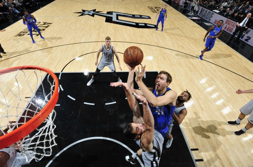 ANTONIO, TX - DECEMBER 16: Dirk Nowitzki #41 of the Dallas Mavericks goes to the basket against the San Antonio Spurs on December 16, 2017 at the AT&T Center in San Antonio, Texas. NOTE TO USER: User expressly acknowledges and agrees that, by downloading and or using this photograph, user is consenting to the terms and conditions of the Getty Images License Agreement. Mandatory Copyright Notice: Copyright 2017 NBAE (Photos by Mark Sobhani/NBAE via Getty Images)