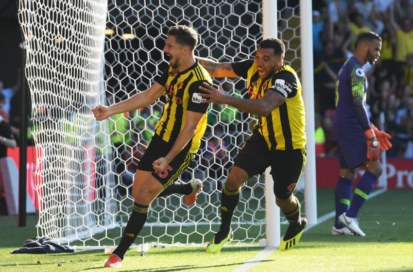 WATFORD, ENGLAND - SEPTEMBER 02: Craig Cathcart of Watford celebrates with his captain Troy Deeney after scoring the winner during the Premier League match between Watford FC and Tottenham Hotspur at Vicarage Road on September 2, 2018 in Watford, United Kingdom. (Photo by Mike Hewitt/Getty Images)