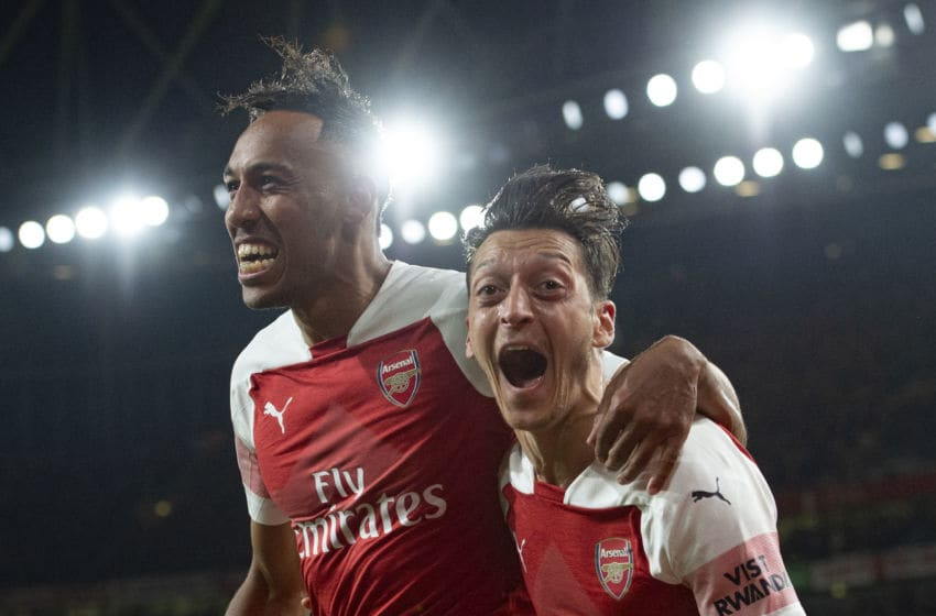 LONDON, ENGLAND - OCTOBER 22: Pierre-Emerick Aubamayang of Arsenal celebrates with Mesut Ozil after scoring Arsenal's third goal during the Premier League match between Arsenal FC and Leicester City at the Emirates Stadium on October 22, 2018 in London, United Kingdom. (Photo by Visionhaus/Getty Images)