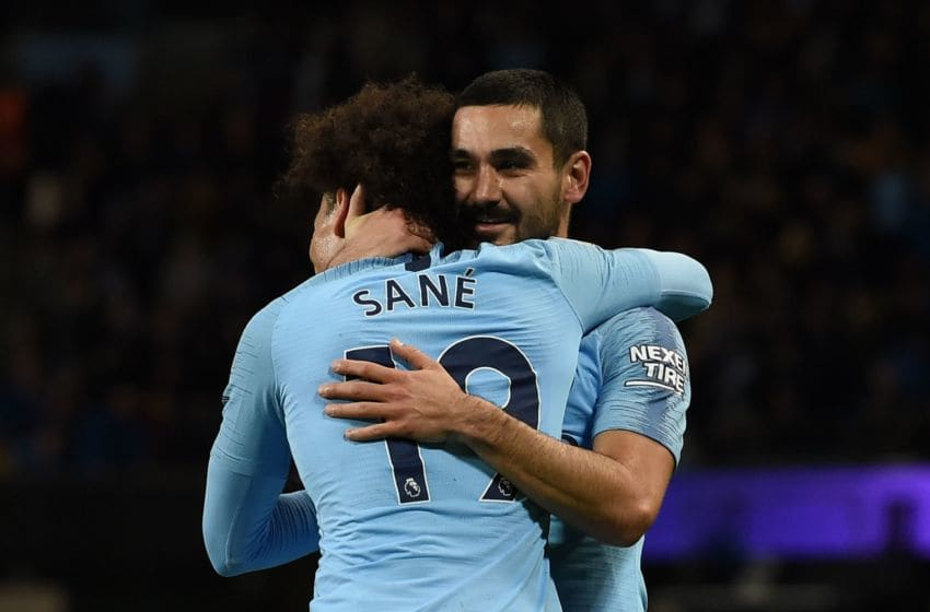 Manchester City's German midfielder Ilkay Gundogan (R) celebrates scoring their third goal for 3-1 with Manchester City's German midfielder Leroy Sane (L) during the English Premier League football match between Manchester City and Bournemouth at the Etihad Stadium in Manchester, north west England, on December 1, 2018. (Photo by Paul ELLIS / AFP) / RESTRICTED TO EDITORIAL USE. No use with unauthorized audio, video, data, fixture lists, club/league logos or 'live' services. Online in-match use limited to 120 images. An additional 40 images may be used in extra time. No video emulation. Social media in-match use limited to 120 images. An additional 40 images may be used in extra time. No use in betting publications, games or single club/league/player publications. / (Photo credit should read PAUL ELLIS/AFP via Getty Images)