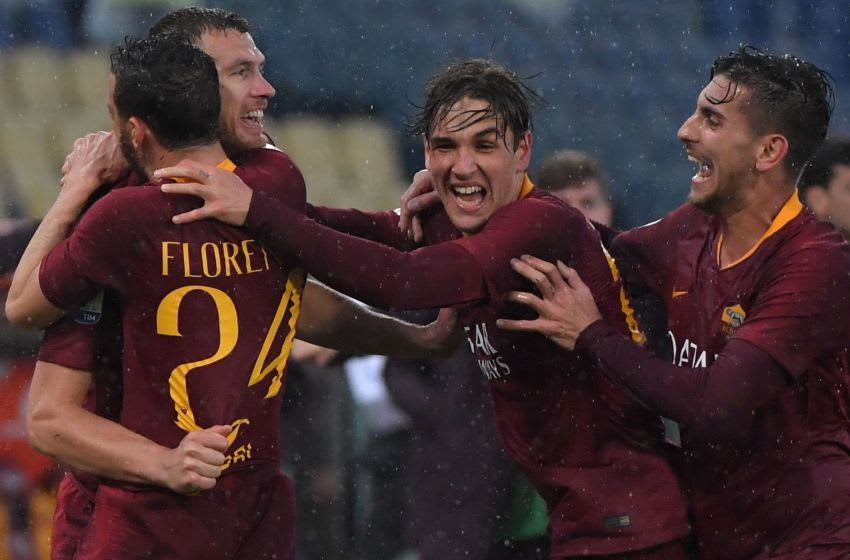 AS Roma Bosnian forward Edin Dzeko celebrates with AS Roma Italian midfielder Alessandro Florenzi (L), AS Roma Italian midfielder Nicolo Zaniolo (C) and AS Roma Italian midfielder Lorenzo Pellegrini (R) after opening the scoring during the Italian Serie A football match AS Roma vs Udinese on April 13, 2019 at the Olympic stadium in Rome. (Photo by Tiziana FABI / AFP) (Photo credit should read TIZIANA FABI/AFP via Getty Images)