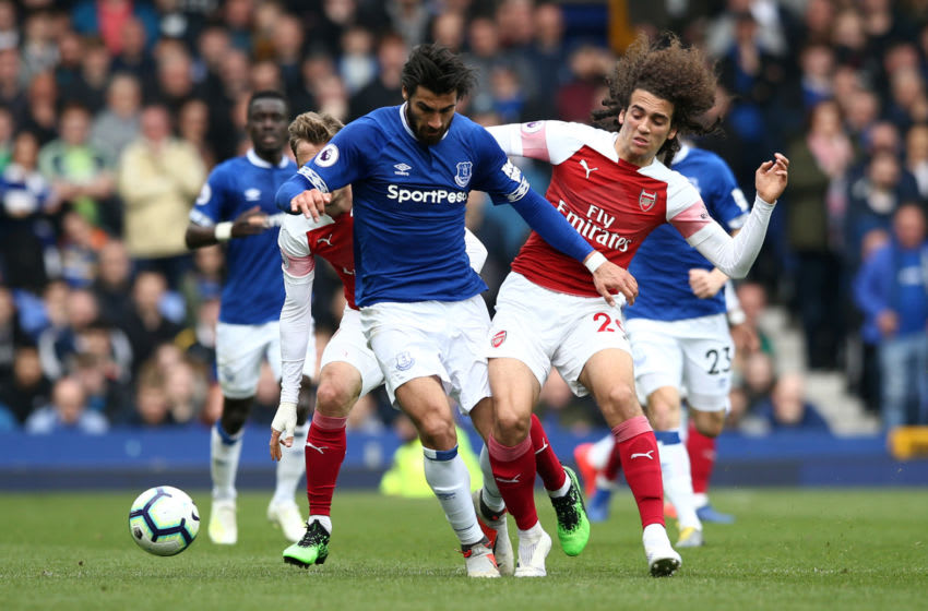 LIVERPOOL, ENGLAND - APRIL 07: Andre Gomes of Everton is challenged by Matteo Guendouzi of Arsenal during the Premier League match between Everton FC and Arsenal FC at Goodison Park on April 07, 2019 in Liverpool, United Kingdom. (Photo by Jan Kruger/Getty Images)