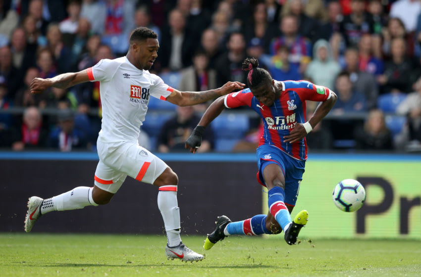 LONDON, ENGLAND - MAY 12: Wilfried Zaha of Crystal Palace shoots in the build up to his team's third goal during the Premier League match between Crystal Palace and AFC Bournemouth at Selhurst Park on May 12, 2019 in London, United Kingdom. (Photo by Steve Bardens/Getty Images)